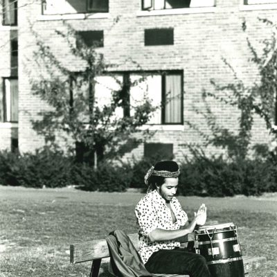 Student plays a bongo