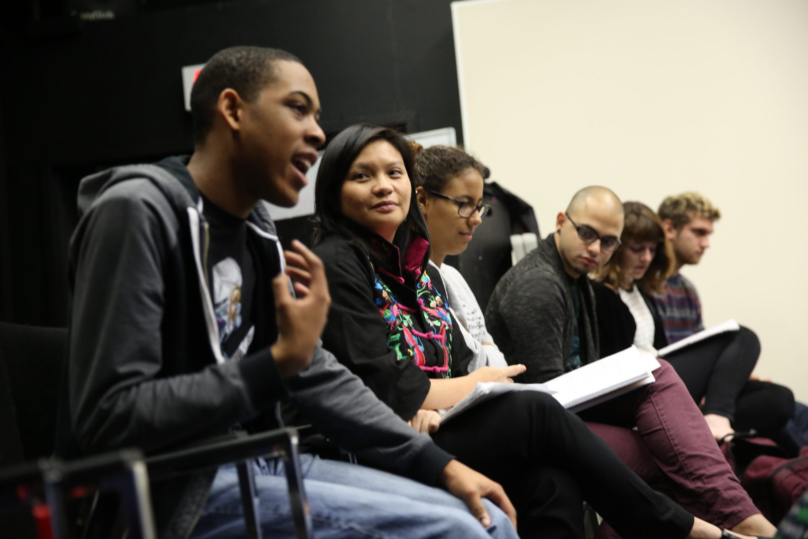 students and professor seated in row