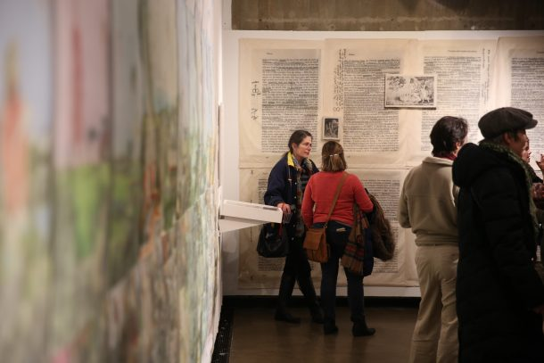 Community members engaging at the Prisons Gallery opening
