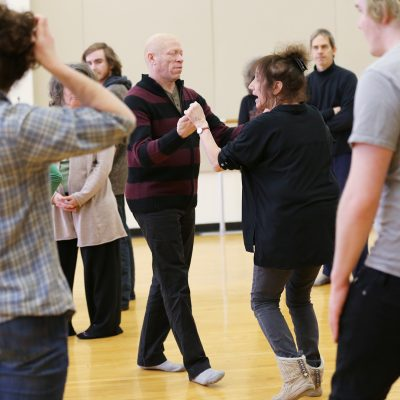 participants in dance class move in pairs