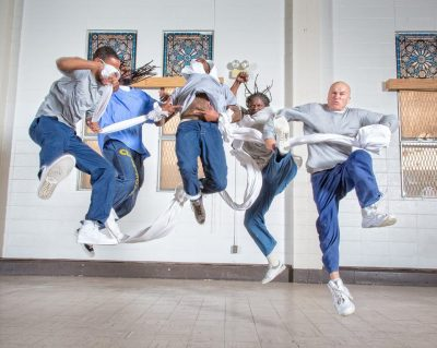 Five artists jumping