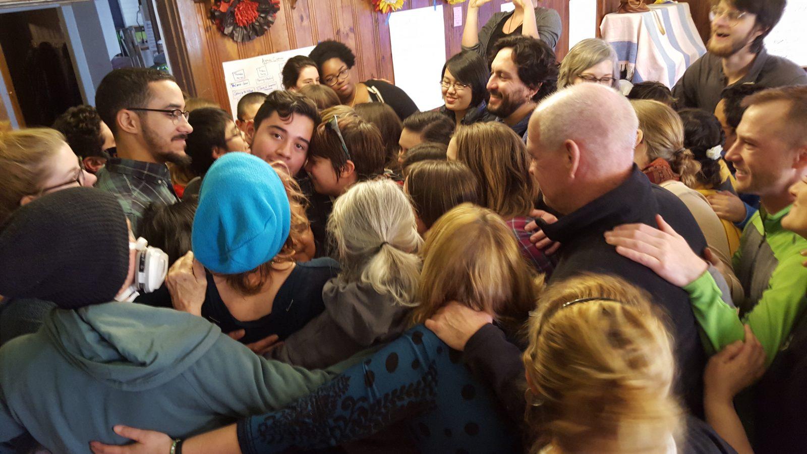 Large group hug at training