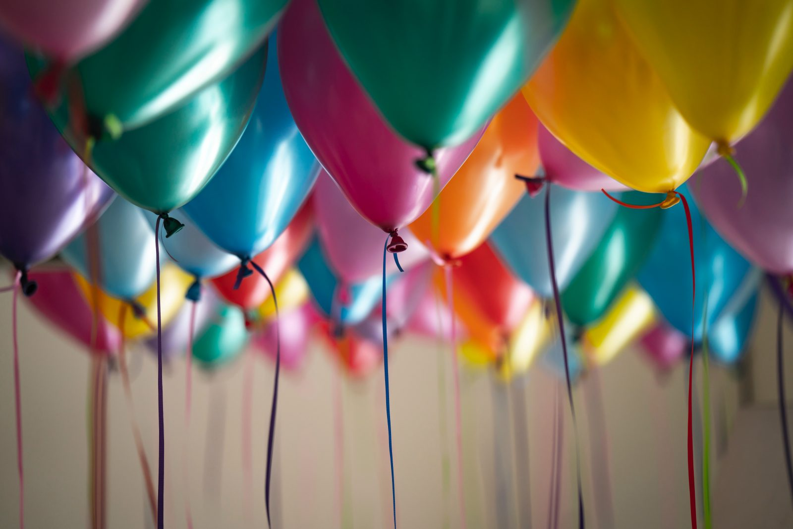 Close up photo of multi-colored balloons