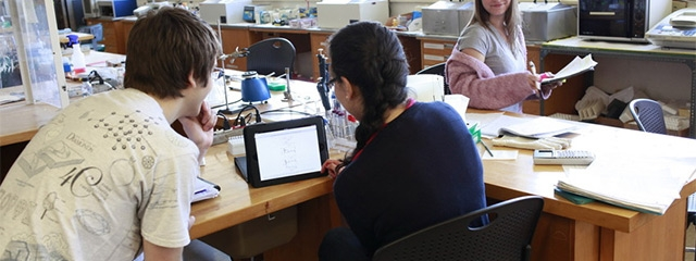 Hampshire College students in a science lab