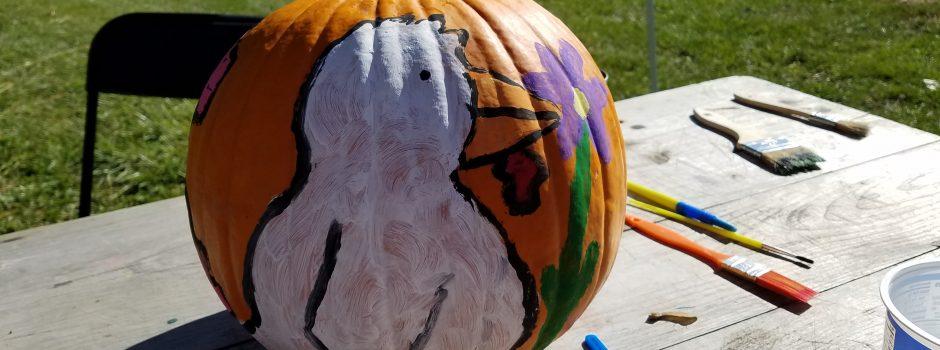 pumpkin with cartoon bird painted on it