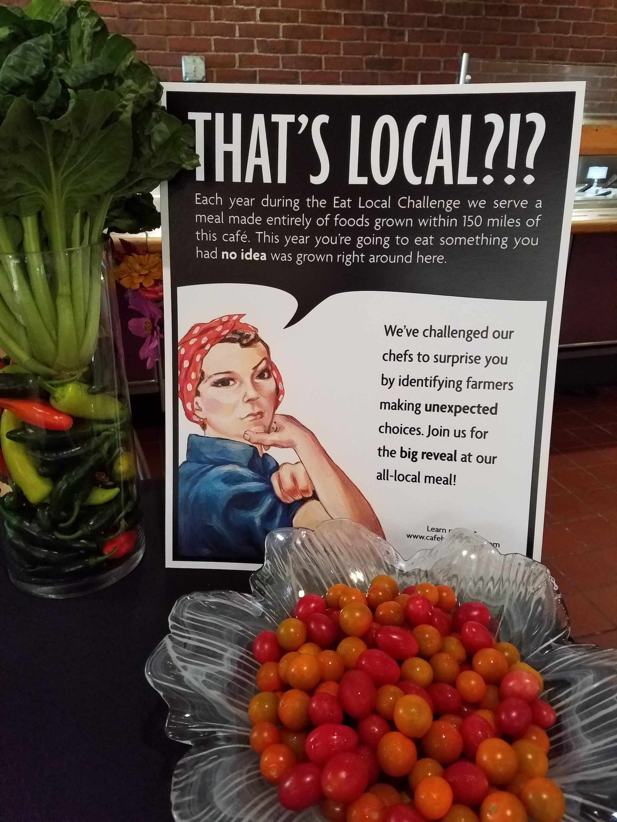 """That's Local?!? poster on table with bowl of cherry tomatoes"