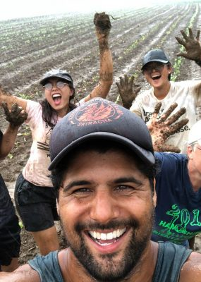laughing farmers covered in mud