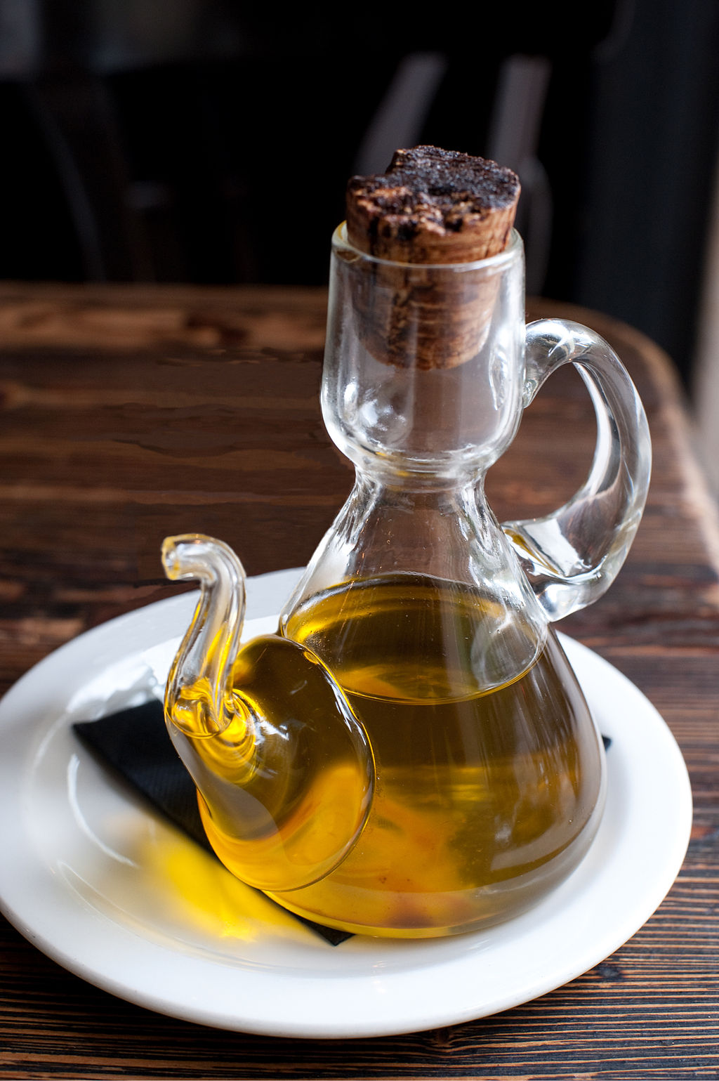 delicate glass jar of olive oil