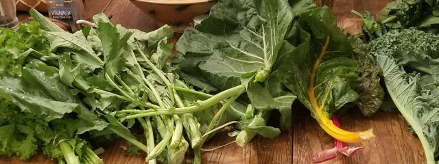many types of greens on a table
