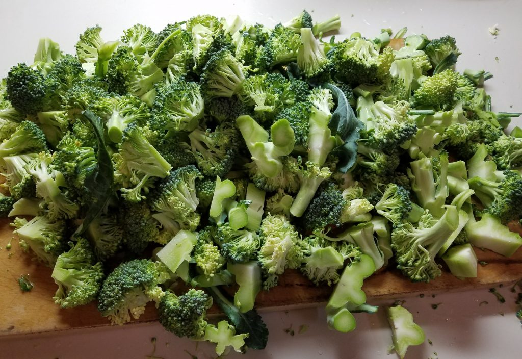 chopped broccoli on a cutting board