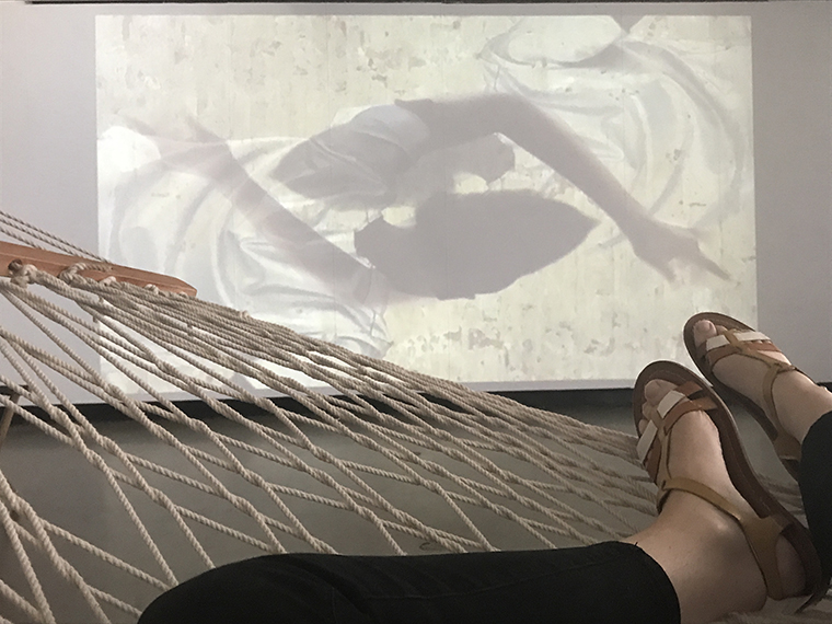 Video installation, feet on hammock