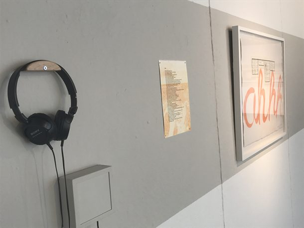 Installation of headphones and two prints