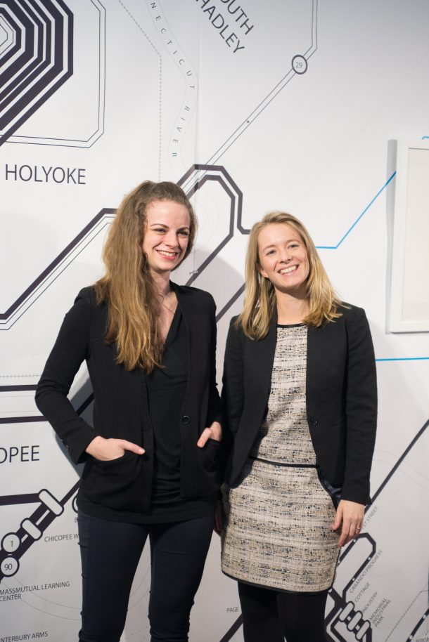 Amy Halliday and Julia Buntaine standing in front of the map wall