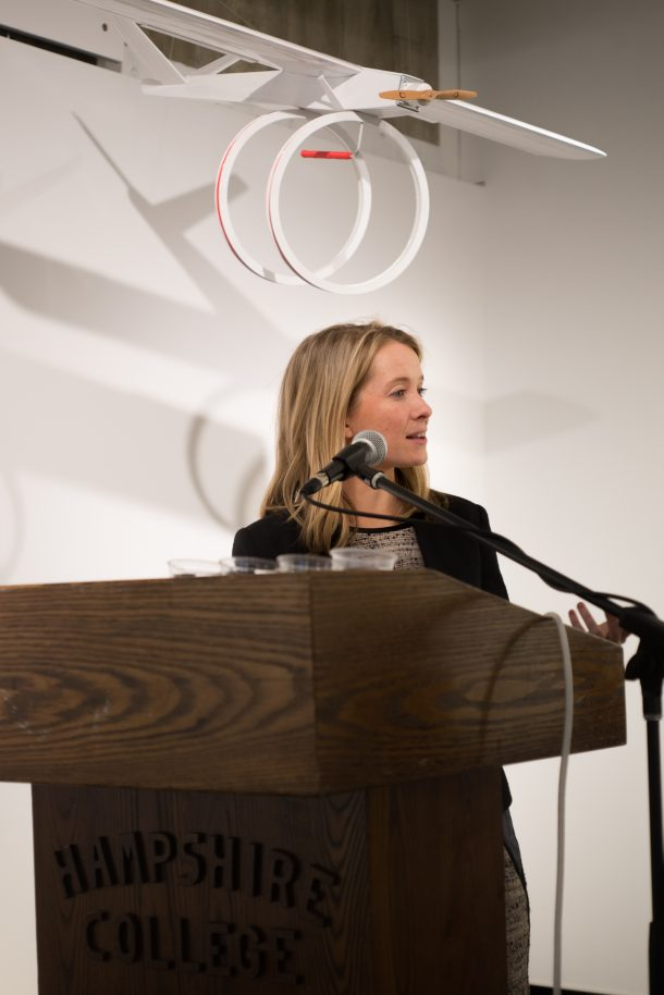 Gallery Director Amy Halliday speaking behind podium