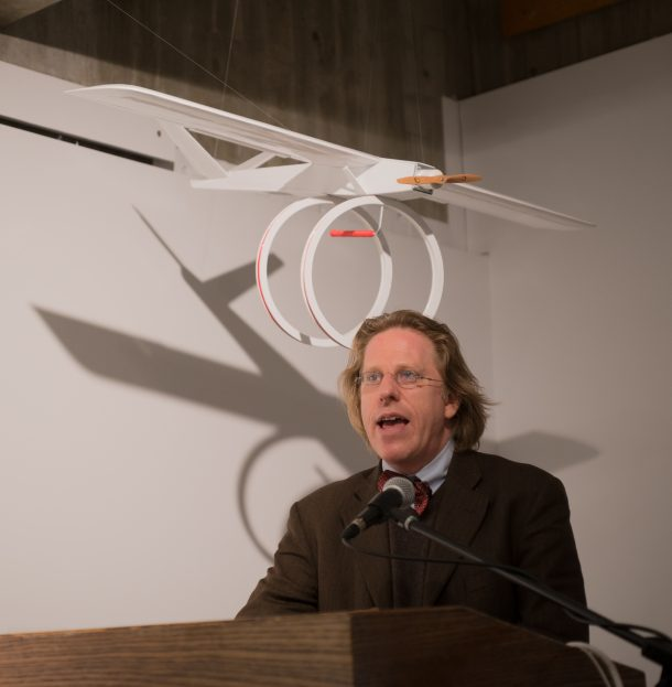 Jonathon Keats speaking with one of his biomimicry models above him