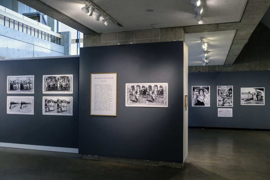installation shot of the introductory statement about the exhibition, with archival photographs to either side and in the background