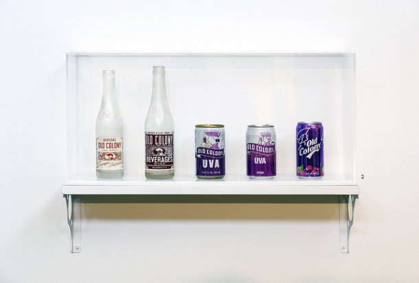 Shelf with a variety of Old Colony brand soda bottles