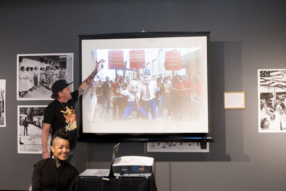 AgitArte's Artistic Director Jorge Díaz Ortiz and Dey Hernández presenting about AgitArte & Papel Machete