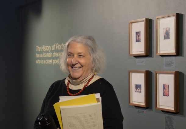 Sura Levine smiling in front of Seydel artworks