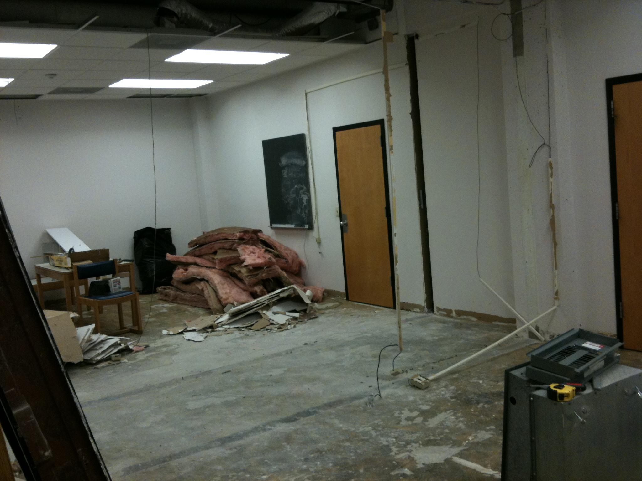 By noon on Monday, all the walls between Rae-Ann's old office, the projection room and Googie are all down.