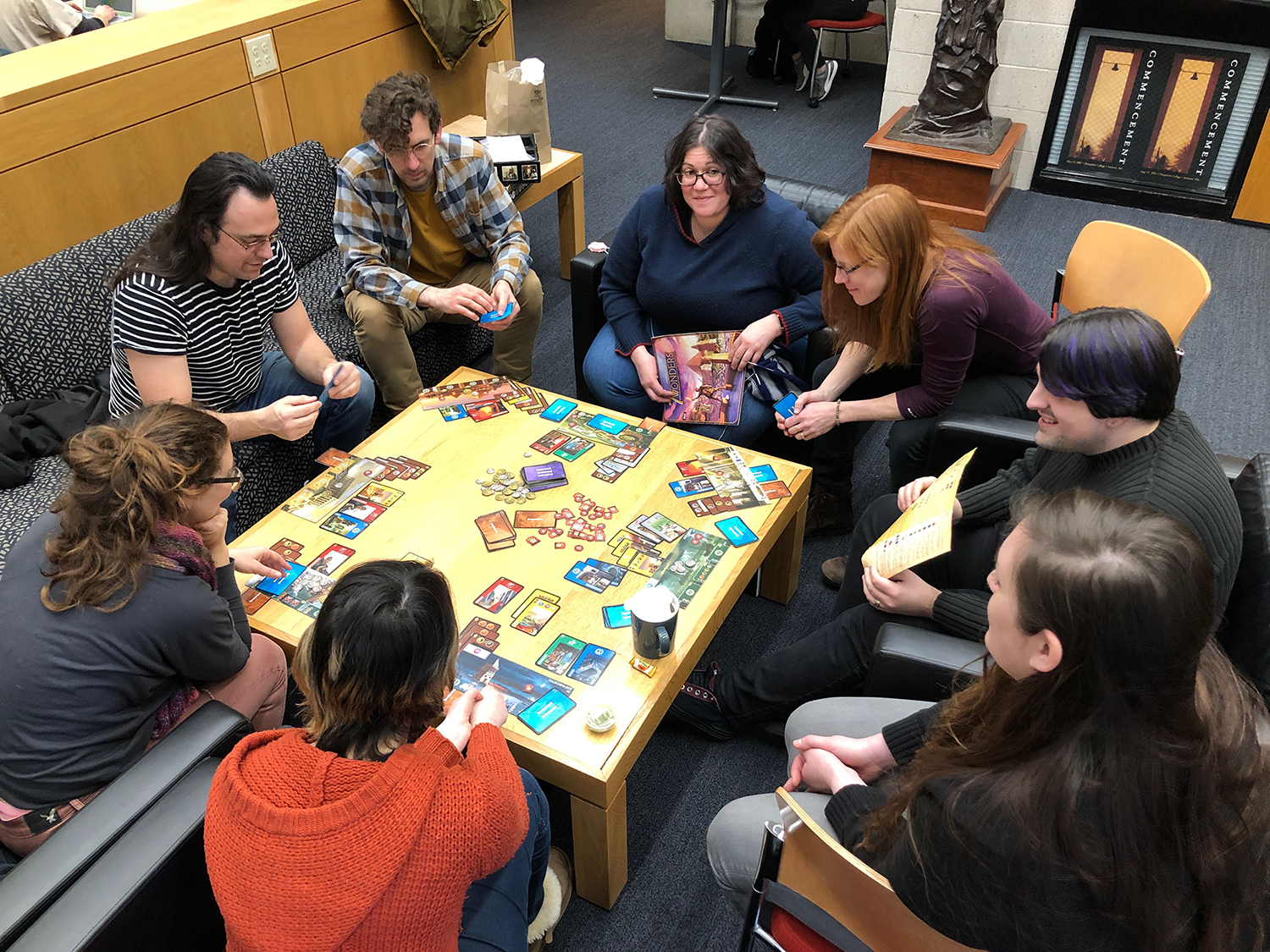 IT and library staff playing a board game