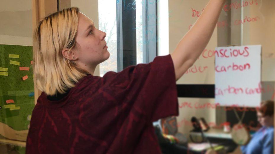Meredith writing on glass