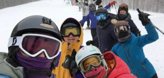 Students posing for a photo while skiing