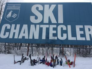 Students skiing near a sign in Quebec