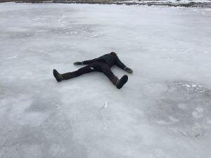 Student lying on the ice resting