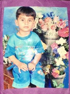 A photo of Adil as a young child