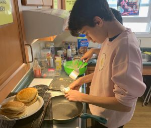 Student cooking breakfast