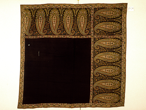 Maker: Unknown Culture: French (possibly) Title: Shawl Date Made: 1820-1840 Type: Clothing Materials: Textile: black twill weave wool or silk (warp) and wool (weft); polychrome block printed design Place Made: France (possibly) Measurements: Overall: 55 in x 57 in; 139.7 cm x 144.78 cm Credit Line: Gift of Mr. and Mrs. Parker Hubbard Accession Number: 89.074 Collection: Historic Deerfield