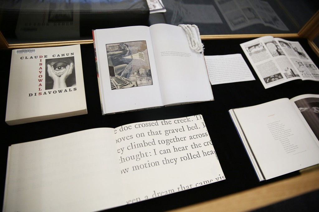 Photo of the top of an open display case in which several pieces (primarily books) are on display.