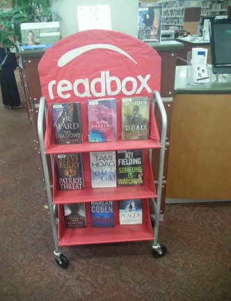 Parody of DVD rental system Redbox at library called Readbox and offering books.