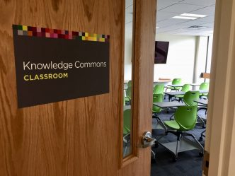 New classroom at knowledge commons is equipped with sets of comfortable chairs and desks, a brand-new TV and whiteboard.