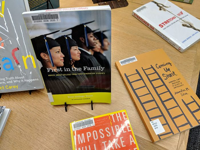 A photograph of some books for first-gen students on display