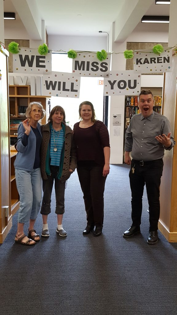 "Karen with colleagues under the ""We Will Miss You"" sign!"
