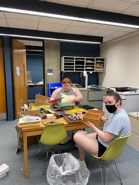 Library staff cleaning out the Main Office